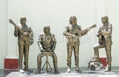 TRINIDAD, CUBA-JULY 22,2014: Statue honoring The Beatles in the Music House. The Beatles were censured in Cuba and after a rectification nowadays they are honored by the goverment