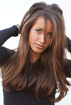 Perfect Hair! dark brown hair with lighter brown highlights. I like the cut and style too.