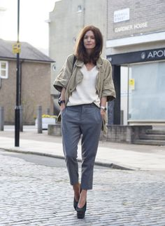Parka by Isabel Marant, trousers Cos, knit Topshop, shoes Acne, bracelet Cooee, watch Tagheuer and bag Isabel Celine.