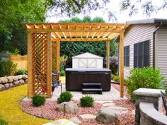 Google Image Result for http://stevejacksoncarpentry.com/wp-content/uploads/2011/07/Gazebo-with-hot-tub-and-landscaping.jpg