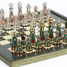 Sofisticato Chess Set from Italy - one of the most beautiful.The pieces are solid brass plated with gold/silver with a special processed wood in between. The chess board is inlaid Italian briarwood and white birdseye maple from Italy Classic Board Games, Vintage Board Games, Chess Pieces, Game Pieces, Chess Set Unique, Chess Players, Kings Game, Chess Sets, Cool Stuff