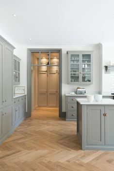 -Design Trend: Herringbone Wood Floors herringbone wood floor with gray shaker kitchen cabinets Grey Shaker Kitchen, Shaker Kitchen Cabinets, Kitchen Cabinet Design, Kitchen Interior, Kitchen Decor, Kitchen Ideas, Kitchen Tips, Shaker Style Kitchens, Kitchen Modern