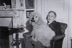 [Gertrude Stein in her home at rue Christine with her poodle on her lap. Dog Bike Carrier, Dog Bike Basket, Dog Bike Trailer, Biking With Dog, Dog Calendar, Cinema, Historical Pictures, Dog Life, Animals And Pets