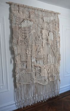 """LARGE MACRAME WEAVING WALL HANGING  NEUTRAL TONES AND NATURAL FIBERS COMBINE FOR THIS UNIQUE AND RICHLY TEXTURED WALL HANGING. THIS MODERN MACRAME AND WEAVING IS HANDMADE IN BROOKLYN, NEW YORK. MATERIALS: LINEN, COTTON, WOOL, SILK, SISAL AND HEMP. DIMENSIONS: 4'-6"""" WIDE, 8' HIGH  FOR CUSTOM ORDERS PLEASE USE THE CONTACT FORM OR   CLICK HERE TO SHOP HERE ON ETSY"""