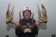 Admirer of a potential world-record typical 12-pointer whitetail rack