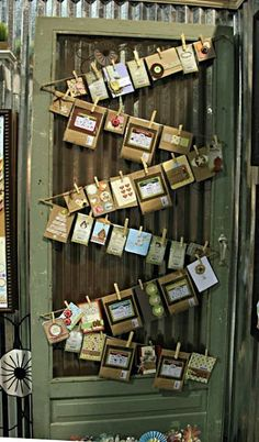 A great way to display photos with an old screen door!