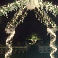 The lighted iron gazebo with tulle & greenery with white wisteria becomes a nice decoration for the reception as well. ( our daughter's wedding)