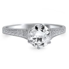 This delicate Edwardian ring features an old European cut diamond in an exquisite and elegant platinum setting. The intricate craftsmanship and shining center diamond make this an ideal engagement ring from the 1920s (approx. 0.96 total carat weight).