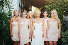 """cream, blush, and nude mismatched bridesmaid dresses"" I kinda like this. Very pretty and allows for more personality."