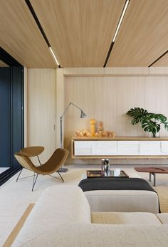 studio arthur casas has collaborated with sysHaus to develop the sysHaus house, a 200 sqm prefabricated residence in sao paulo. Living Room Sets, Living Room Chairs, Rugs In Living Room, Living Room Interior, Living Room Furniture, Room Rugs, Prefabricated Houses, Prefab Homes, Modular Homes