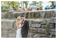 The newlyweds posing in front of our beautiful cascading infinity pool outside on the patio at Saratoga National.