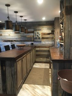 he transformation turned into a rustic man cave where the family now spends the most time! A custom built in bar, exposed brick and barn wood wall and oxidized copper ceiling are just some of the features added to this space. #Basement bar