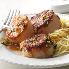 Skillet Sea Scallops Recipe -You'll want to slip this recipe into the front of your last-minute guests file. Pasta and mixed greens nicely complement the tender, citrusy shellfish. —Margaret E. Fish Dishes, Seafood Dishes, Fish And Seafood, Seafood Recipes, Dinner Recipes, Cooking Recipes, Healthy Recipes, Main Dishes, Thai Shrimp
