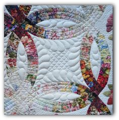 """close up, award-winning """"Rings and Roses"""" by Janet Treen at Quiltsalott.  Posted at Celebrate Hand Quilting.  Here you can see the quilting, and the way in which Janet created a colorwash effect, by introducing gradations of floral prints"""