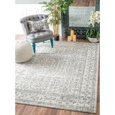 Soft and plush, the pile on this contemporary area rug is made from 100% polypropylene to prevent shedding, and will tie together any fashionable space. Add a sense of vintage flair to any living room