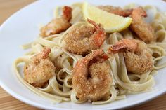Jumbo Shrimp Parmesan - a family favorite for many years.  Very light and delicious. Plain breadcrumbs work the best for this.  Don't forget the lemon wedges. ~Suz