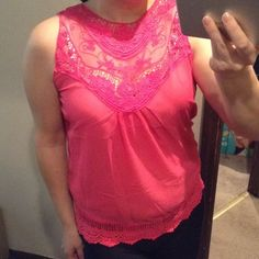 "Pink lace tank top Really lightweight, color is bright pink although it looks a bit orange in the photos it definitely pink, pretty lace accents around the neckline and hem, this will fit up to 42"" bust, length is 25"" Boutique Tops Tank Tops"