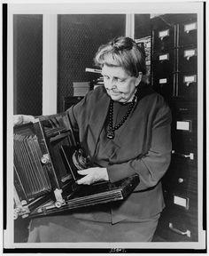 Frances Benjamin Johnston,  Johnston holding camera, between 1940 and 1952