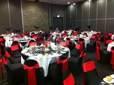 Corporate Event in WatervieW, Sydney with black lycra chair covers and red sashes
