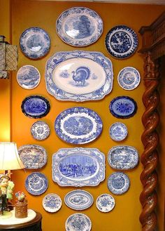Blue and white dishes on wall