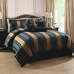 Bring chic and sophisticated style to your bedroom with the refined Midnight Stripe Comforter Set. Dressed in navy and tan horizontal stripes, the beautiful bedding is a luxurious addition to any room's décor.