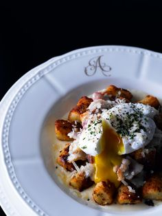 """GNOCCHI CARBONARA."" Homemade gnocchi with caramelized bacon, white wine cream sauce, poached egg, and aged Parmesan cheese ★"