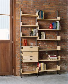 AS4 hand made modular shelving system with combination standards in solid maple and col-rolled steel. Installated on a brick wall. Modular Furniture, Handmade Furniture, Contemporary Furniture, Furniture Design, Retail Fixtures, Modular Shelving, Minimalist Furniture, Custom Cabinetry, Interactive Design