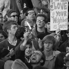An anti-war demonstrator burns his draft card at a Vietnam War protest outside the Pentagon in October 1967. (Photo by Wally McNamee via Corbis)