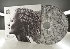 cd cover this is a cool looking design. As you can see her hair carrys on ti the cd.