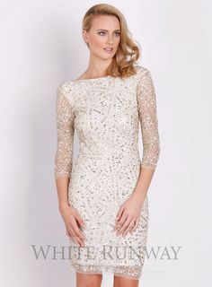 Dahlia Hand-Beaded Shift by Montique. A stunning midi length dress by Australian designer Montique. Hand-embroidered with glittering crystals and beads. This delicate piece is designed to fit slightly loose just skimming the body; lined with sheer 3/4 sleeves.