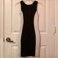 GUESS Bodycon Dress Black & white Bodycon/mini striped dress size from Guess in XS. fits size SM as well. Excellent condition, only worn once. Very tiny black mark on back side that I'm sure can be removed. (Keyword: colorblock) Guess Dresses
