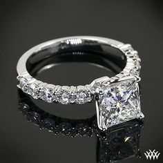 A Pretty Princess: This beautiful Custom Diamond Engagement Ring is set in 18k white gold and holds 0.70ctw in A CUT ABOVE® Hearts and Arrows Diamond Melee. The lovely 4 prong head holds a 2.01ct Princess Cut Diamond.