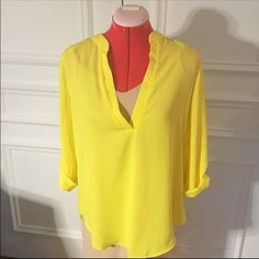 Necessary yellow blouse Add a pop of color with this canary yellow blouse from Necessary Clothing in Soho In excellent condition Size S Necessary Clothing Tops Blouses