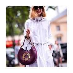 NET-A-PORTER (@netaporter)  CULT CARRYALL: Introducing #Loewe's latest showpiece: the 'Joyce' bag. Toted by the Fashion Week crowd, its crescent-shaped silhouette and jewelry-inspired plaque make it a favorite this fall.  @loewe