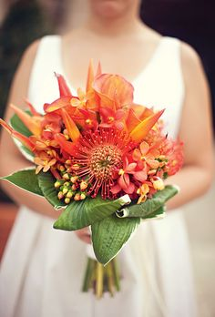 Flower Arrangements For a Destination Wedding  | Orchid, Pincushion Protea, Calla Lily and Hypericum Berry Bouquet | Photo by: Stacy Reeves