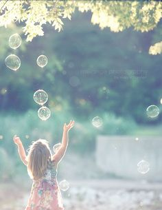 A summer day, no wind, and bubbles!  Kids as well as adults and sometimes the family dog love bubbles.  Did you have bubble solution from the bottle or did your Mom make them with soap?