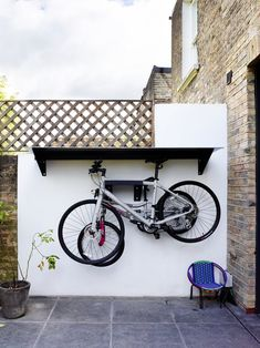 Homes: how a rodent infestation turned out to be a blessing in disguise The steel bike shelter is painted the same shade as the sliding doors. Outside Bike Storage, Garden Bike Storage, Outdoor Bike Storage, Backyard Storage, Bicycle Storage, Shed Storage, Bike Storage Balcony, Bike Storage Room, Garage Storage