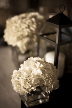Wedding centerpieces - beautiful lanterns and hydrangeas - photo via Widdis Photography.