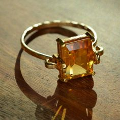 Gold Topaz Ring (18k and 24k Yellow Gold). $350.00, via Etsy.