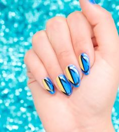 Finding Dory nail art tutorial | Disney Pixar nail polish | [ https://style.disney.com/beauty/2016/06/09/show-your-love-for-dory-with-this-finding-dory-nail-art/ ]