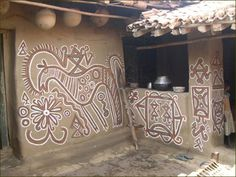 Pithora tribe : used murals or wall paintings to depict their art-works, which are deeply  steeped into their religious and social beliefs.