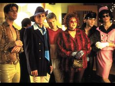 queer as folk -- Loved the lets embarrass the shit outta Mikey outfits. Especially Brian's tacky snake skin and Emmett's Jackie Kennedy getup. Beautiful Outfits, Beautiful Men, Randy Harrison, Brian Kinney, Brian And Justin, History Of Television, Gale Harold, Queer As Folk, Popular Series