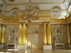 The Armorial Hall, or Guard Room, is decorated with vast stucco panoplies.