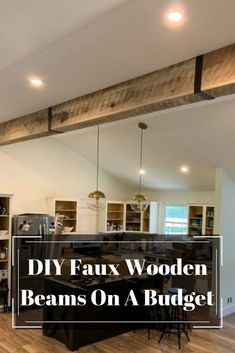 Solid wooden beams are all the rage right now, but a lot of them are too heavy to safely be on the ceiling. We created a budget friendlyy way to add wooden beams to your ceiling! Faux Wooden Beams, Faux Beams, Wooden Beams Ceiling, Wood Beams, Wood On Ceiling Ideas, Fake Beams On Ceiling, Vaulted Ceiling Decor, Beam Ceilings, Modern Farmhouse Decor