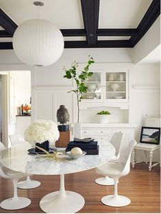 Pristine White with touches of Black Painted wood moulding-Love it.