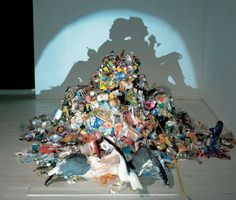 Tim Noble and Sue Webster. They use light and shadow on found objects to create AMAZING work.