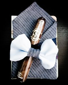 Favor for a Dapper Darling Baby Shower! Chocolate Cigar, Journal, pocket square, and bow tie. How Charming! #babyshower #favor