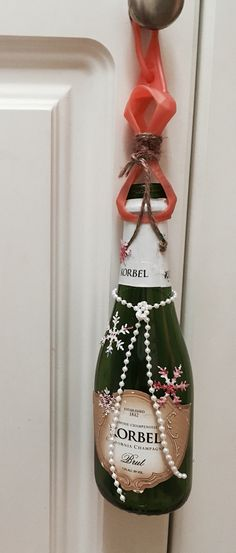 Small champagne bottle hung with hand sanitistizer cover anyplace.. Fill w bells- essential oils- decorate with twine- snowflkes-plastic pearls. Will try Christmas ribbon🎄