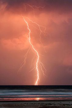 Lightning strikes over the Atlantic Ocean at sunset.  Picture: JASON WEINGART / CATERS NEWS