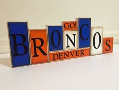 Denver Broncos. These fun blocks will add a unique touch of school spirit to your home decor. These blocks have been hand cut, hand painted and distressed with
